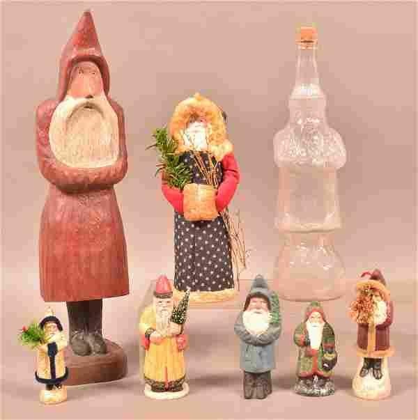 Eight Various Contemporary Santa Figures.