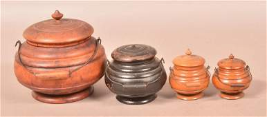 Four Peaseware Maple Covered Canisters.