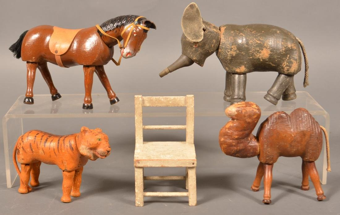 Four Schoenhut Animals and a Chair.