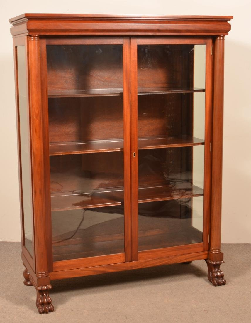federal style mahogany bookcase with carved paw feet