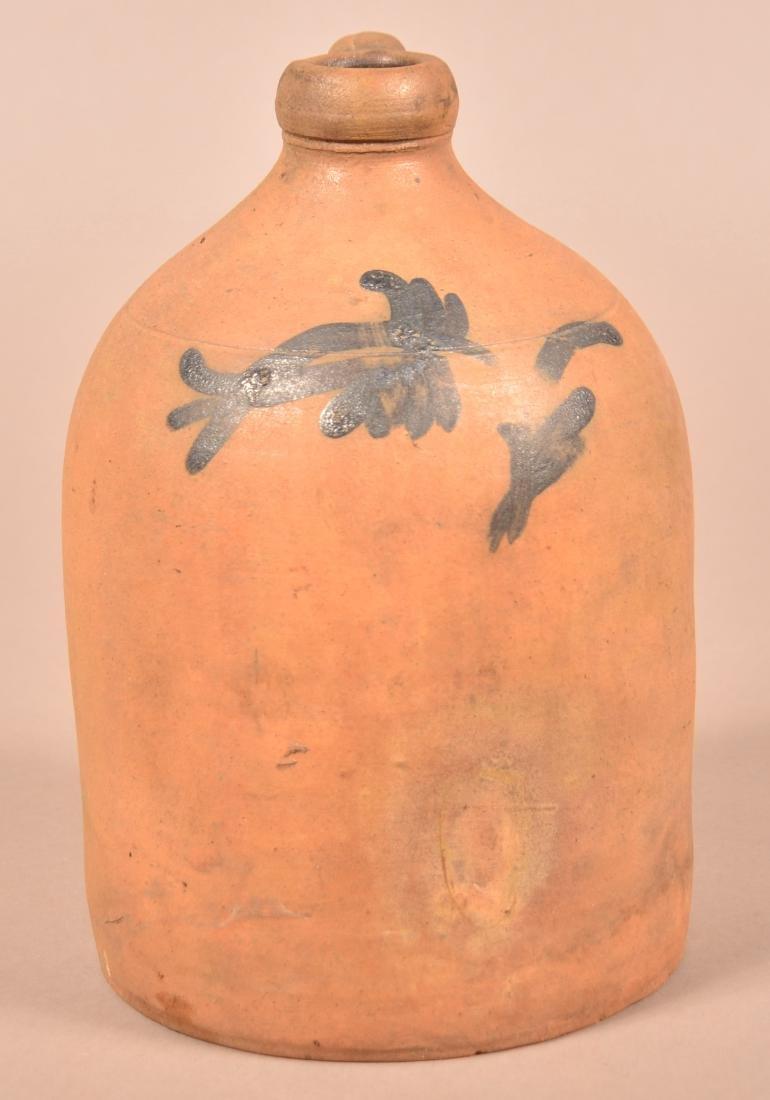 19th Century Unglazed Redware Half Gallon Jug.