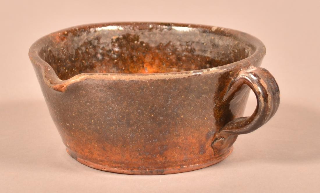 19th Century Glazed Redware Side Spout Sauce Pot.