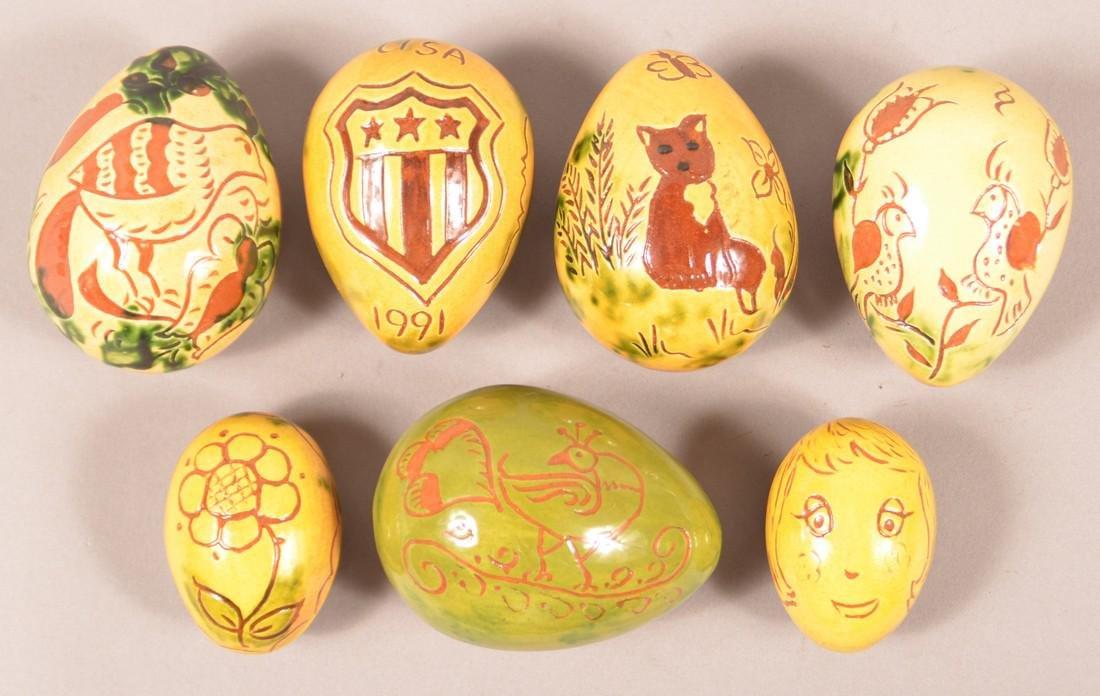 7 Breininger Redware Sgrafitto Decorated Eggs.