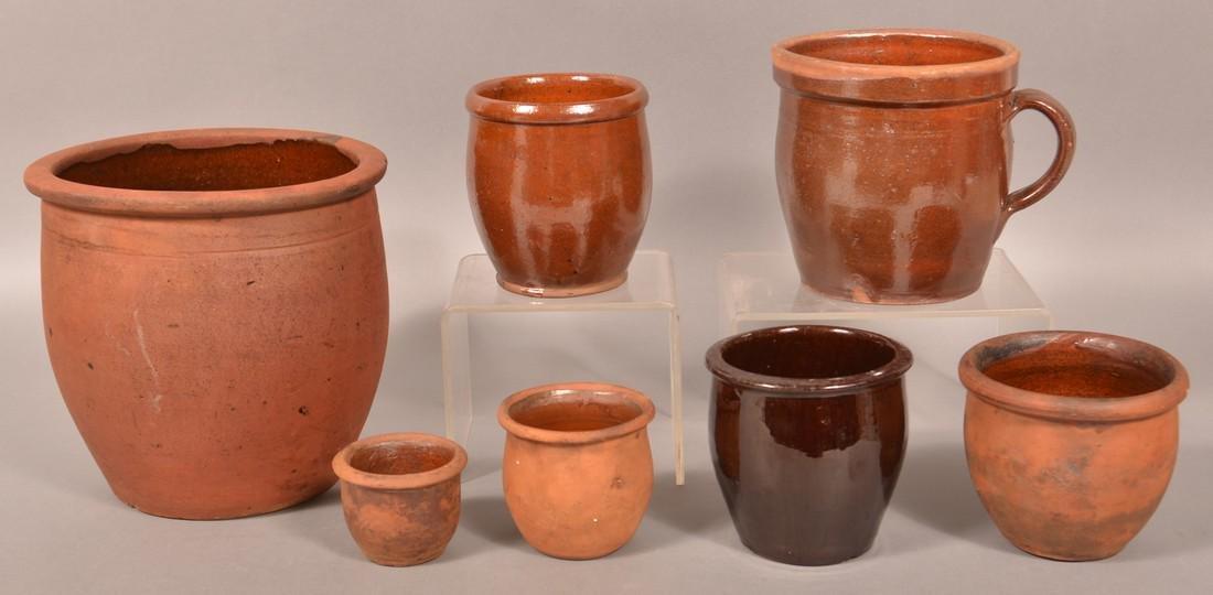 Seven Antique Redware Storage Jars.