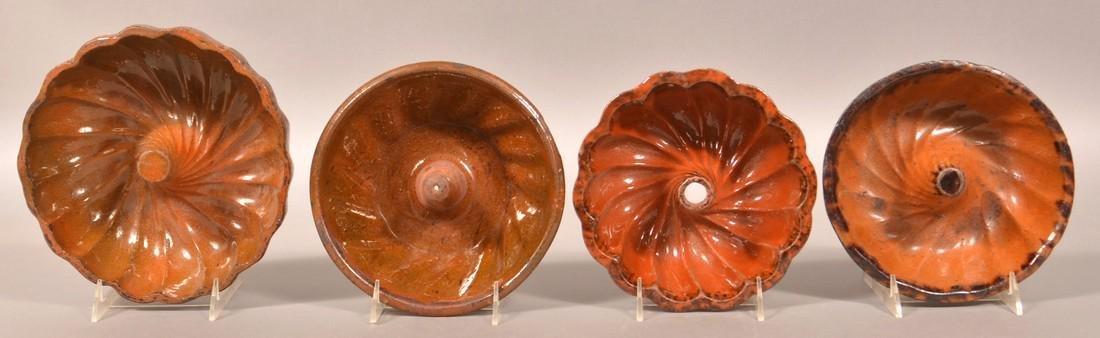 Four Various Glazed Redware Turks Molds.