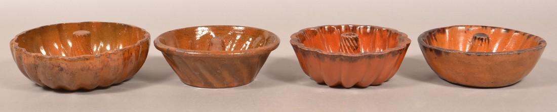 Four Various Glazed Redware Turks Molds. - 2