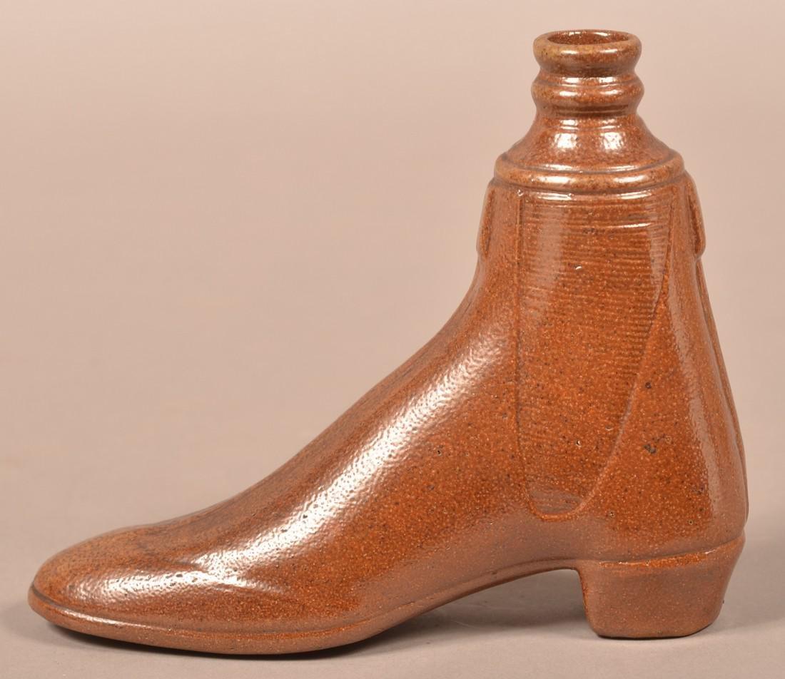 Brown Glazed Stoneware Shoe Form Flask.