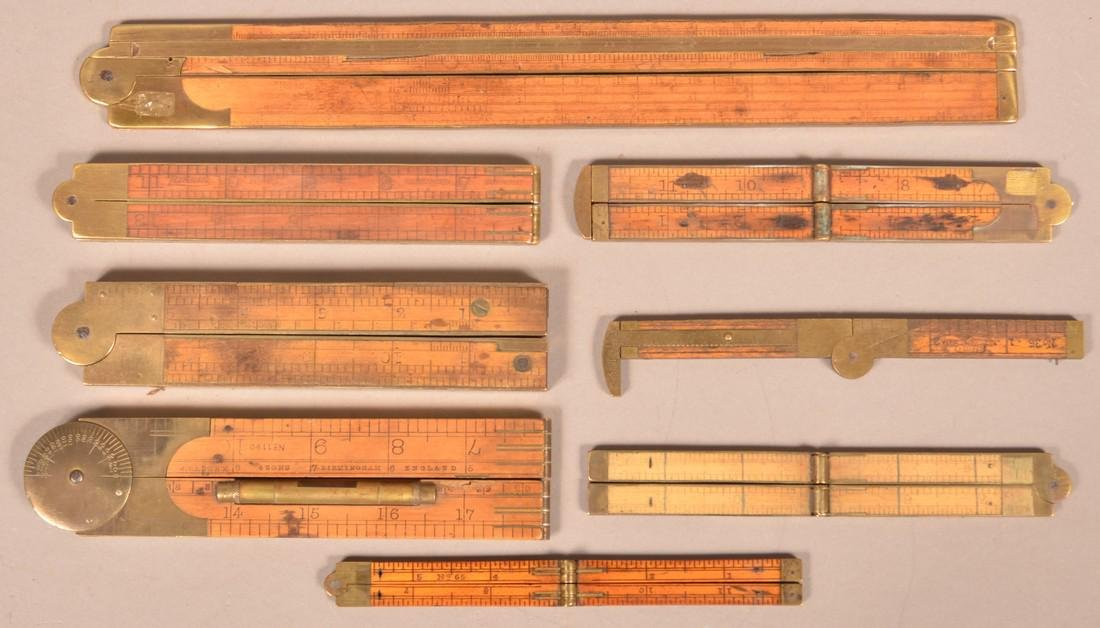 Eight Various Antique Boxwood Folding Rules.