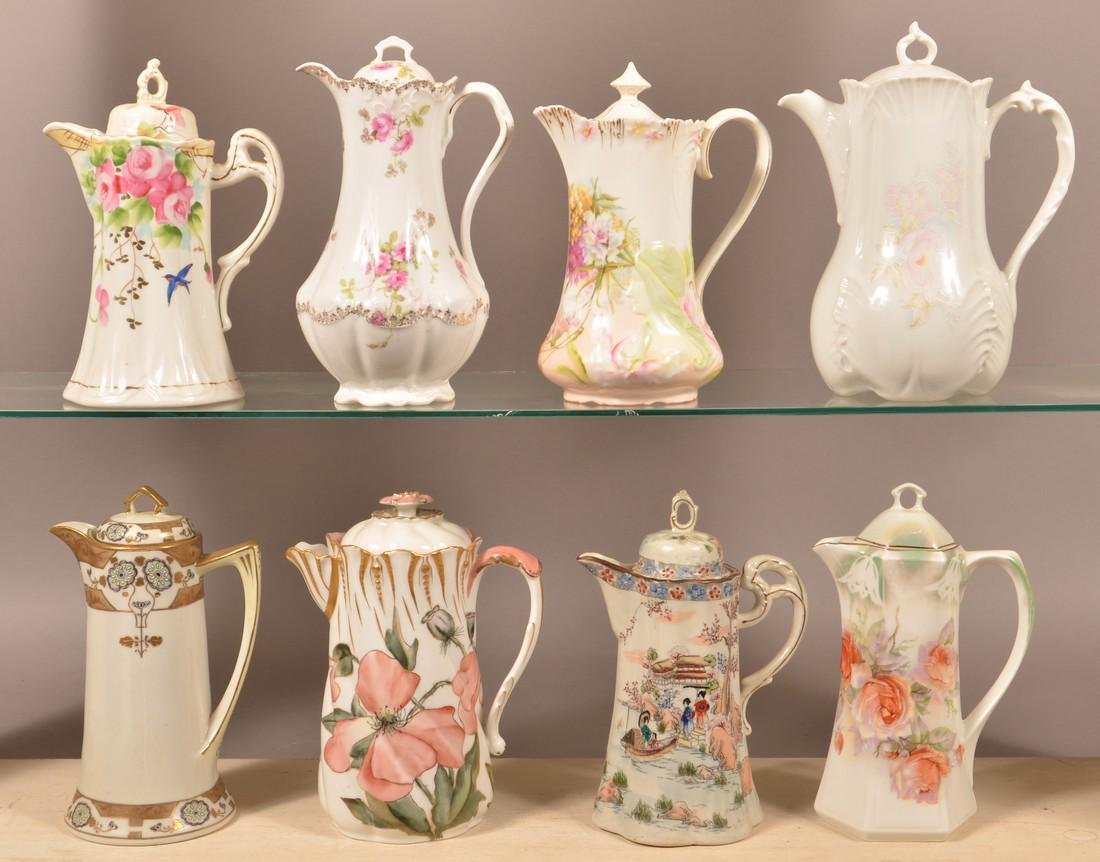 Eight Various Decorated China Chocolate Pots.