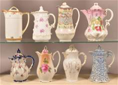 Eight Various Decorated China Chocolate Pots