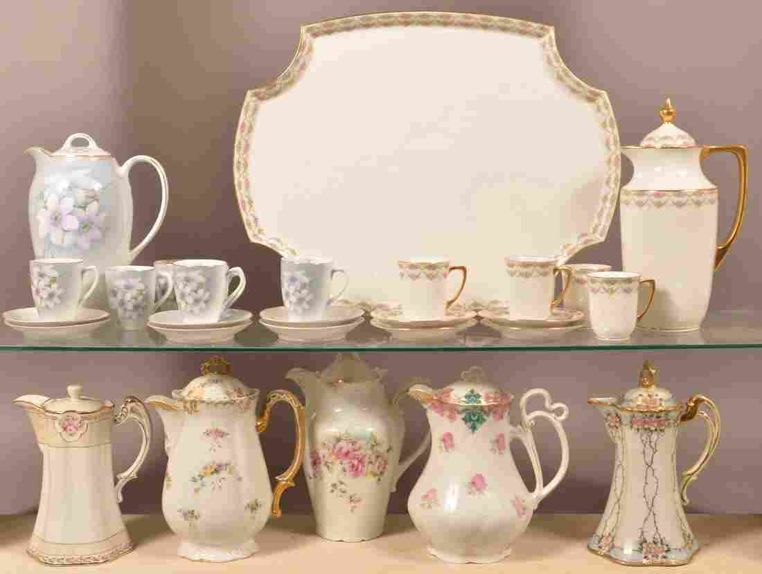 Seven Various Decorated China Chocolate Pots.