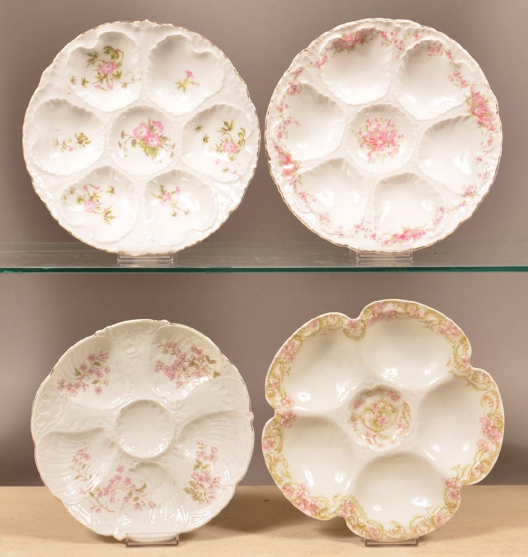 Four Various Decorated China Oyster Plates.