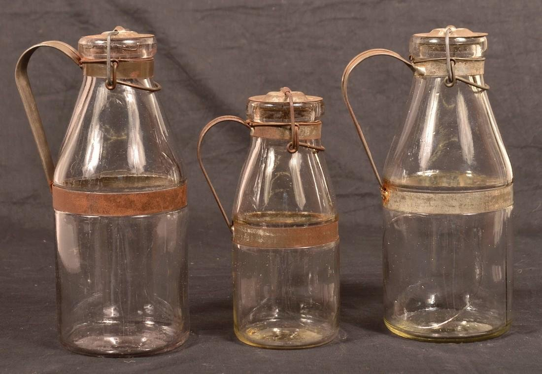 3 A.G. Smalley Tin Mounted Glass Milk Bottles.