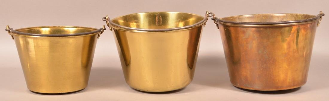 Three Antique Brass Pails with Iron Bail Handles.