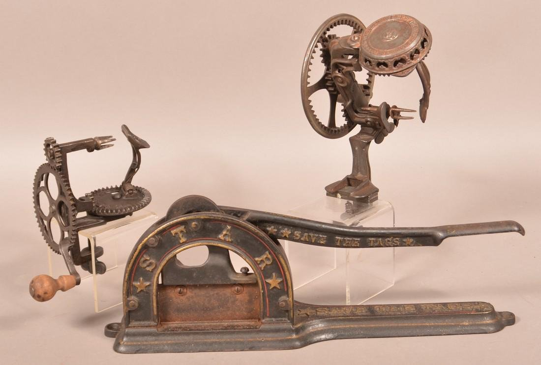 Two Apple peelers and a Tobacco Cutter.