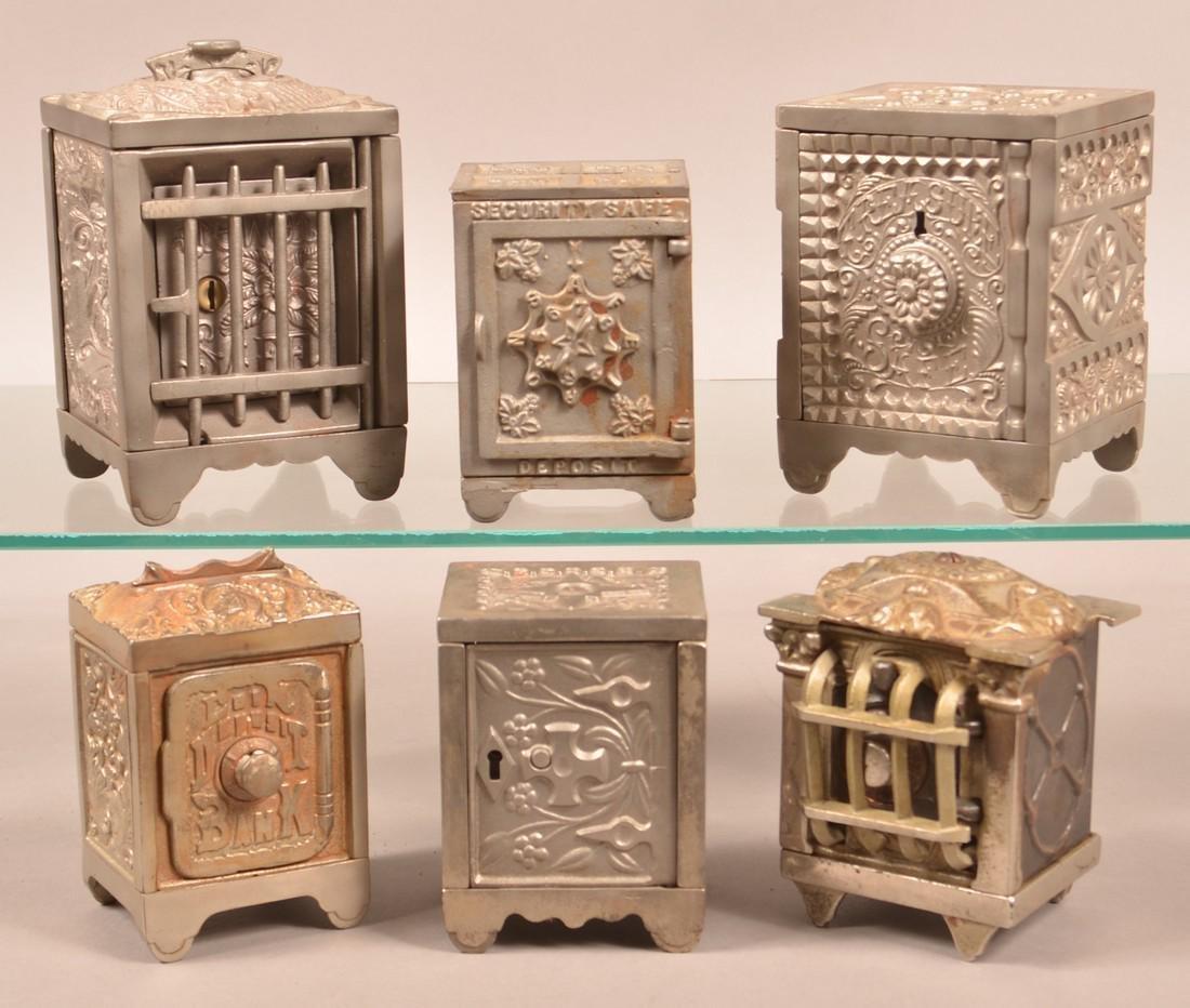 Six Antique/Vintage Cast Iron Safe Still Banks.