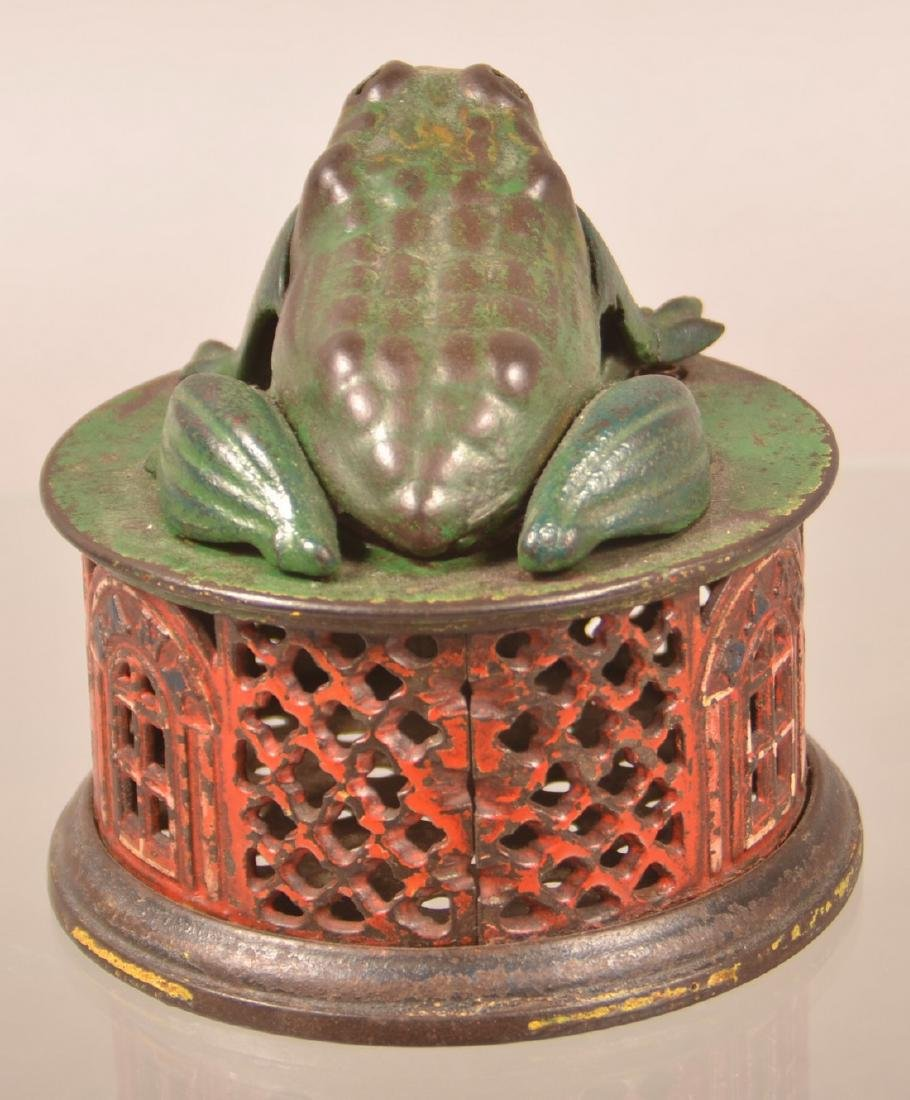 Frog on Lattice Cast Iron Mechanical Bank. - 2