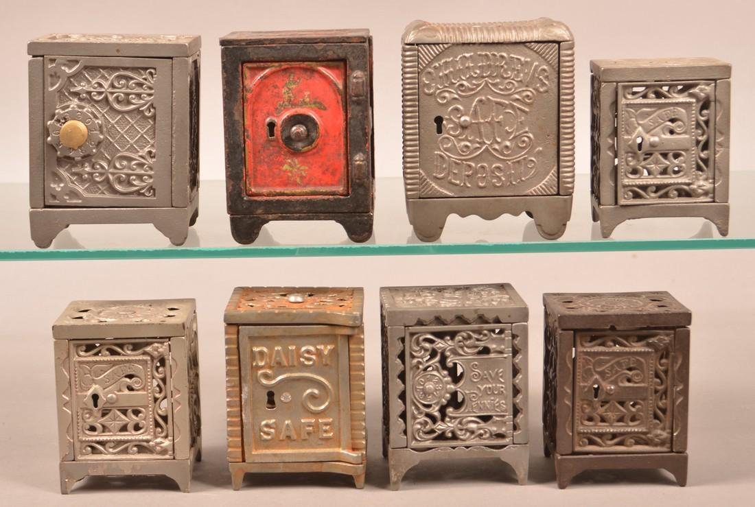 Eight Antique/Vintage Cast Iron Safe Still Banks.