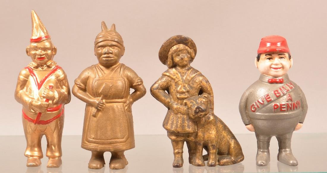 Four Cast Iron Figural Still Banks.
