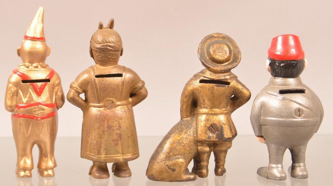 Four Cast Iron Figural Still Banks. - 2