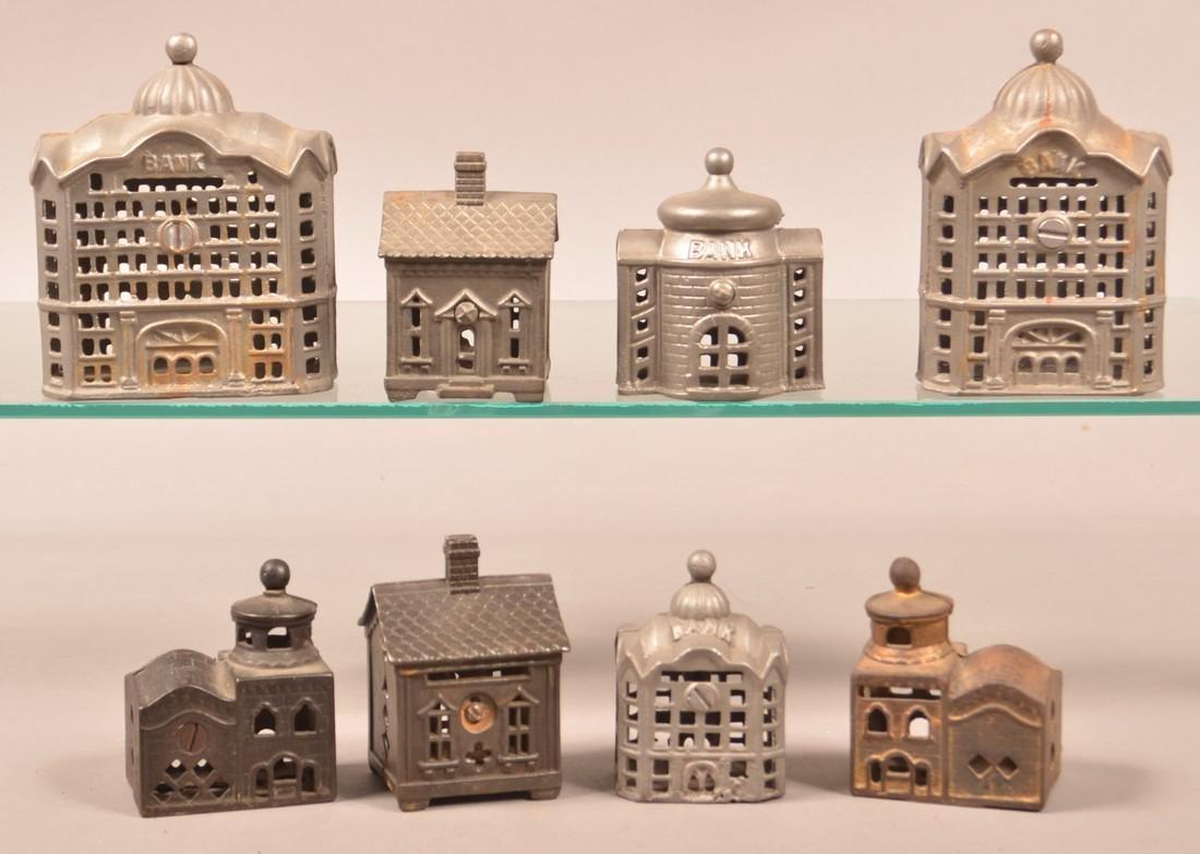 Eight Various Cast Metal Building Still Banks.