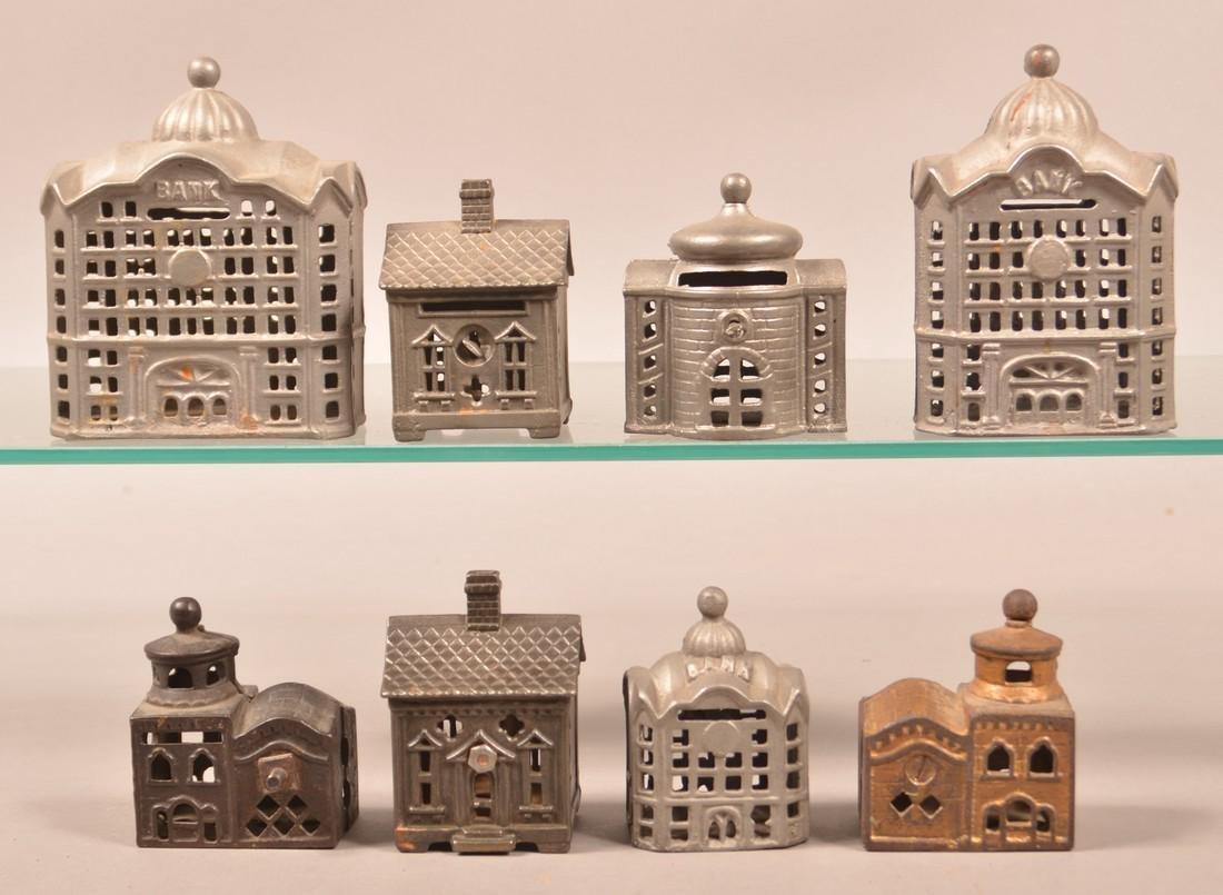 Eight Various Cast Metal Building Still Banks. - 2