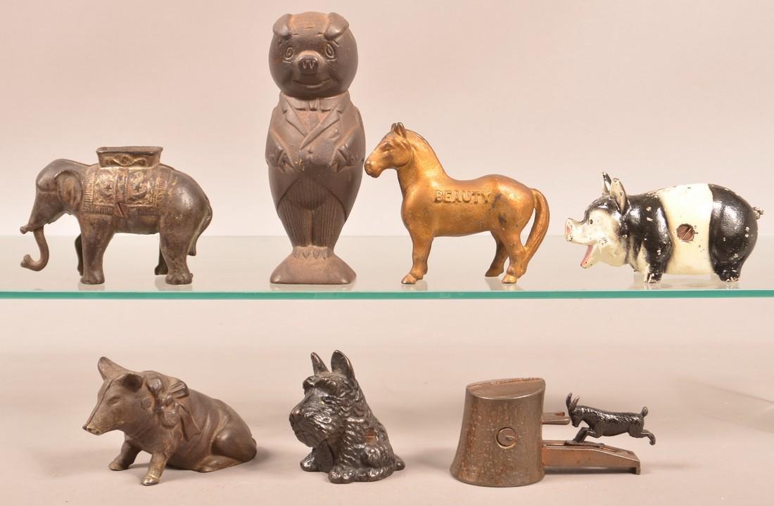 Seven Various Cast Iron Animal Figure Still Banks.