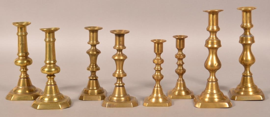Four Pairs of 19th Century Brass Candlesticks.