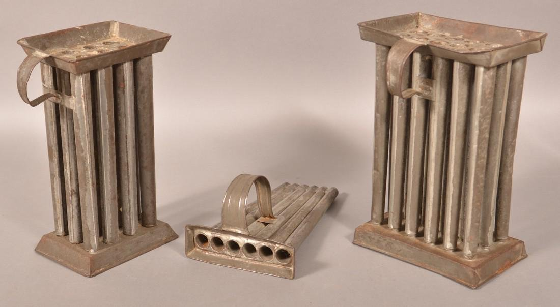 Three Sets of Antique Tin Candle Molds.