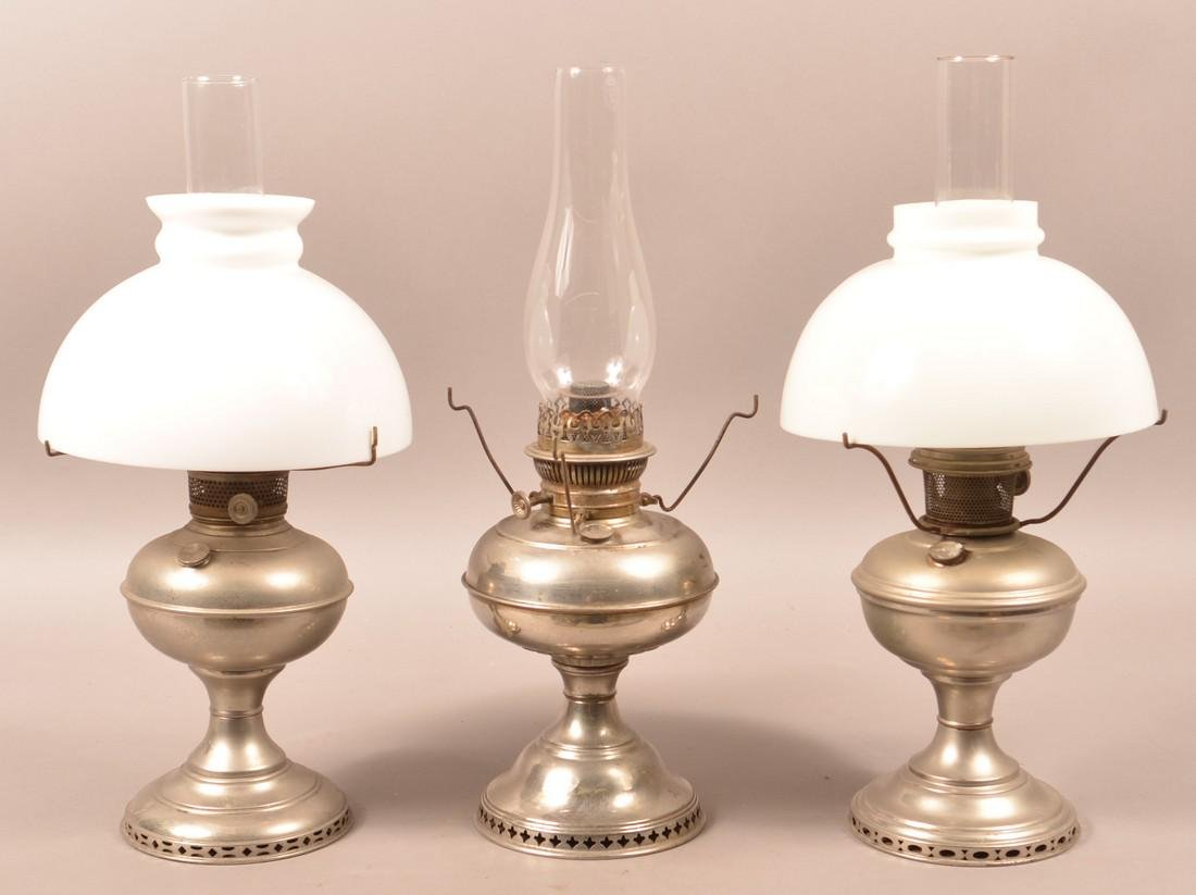 Three Nickle Plated Rayo Type Fluid Lamps.