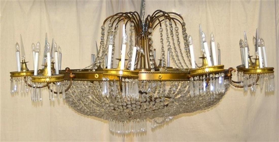 Large Glass Crystals and Gilt Metal Chandelier.