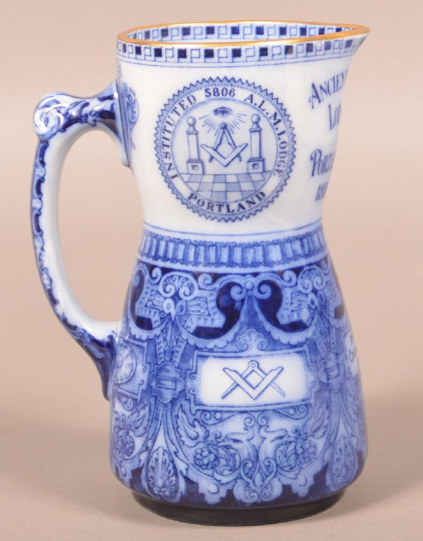 Commemorative Masonic Flow Blue Pitcher.