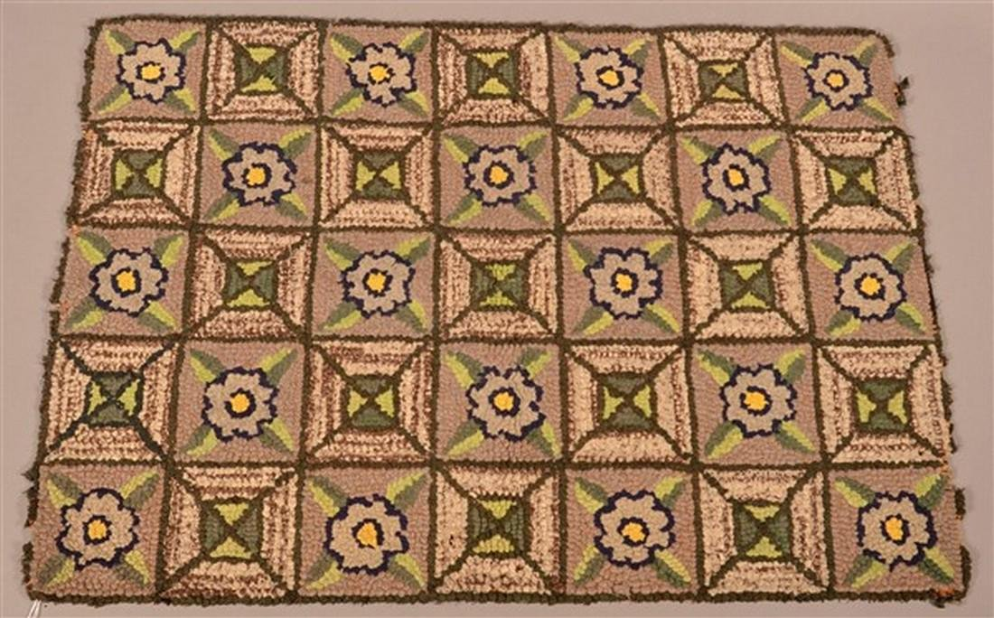 Antique Floral and Geometric Hooked Rug.