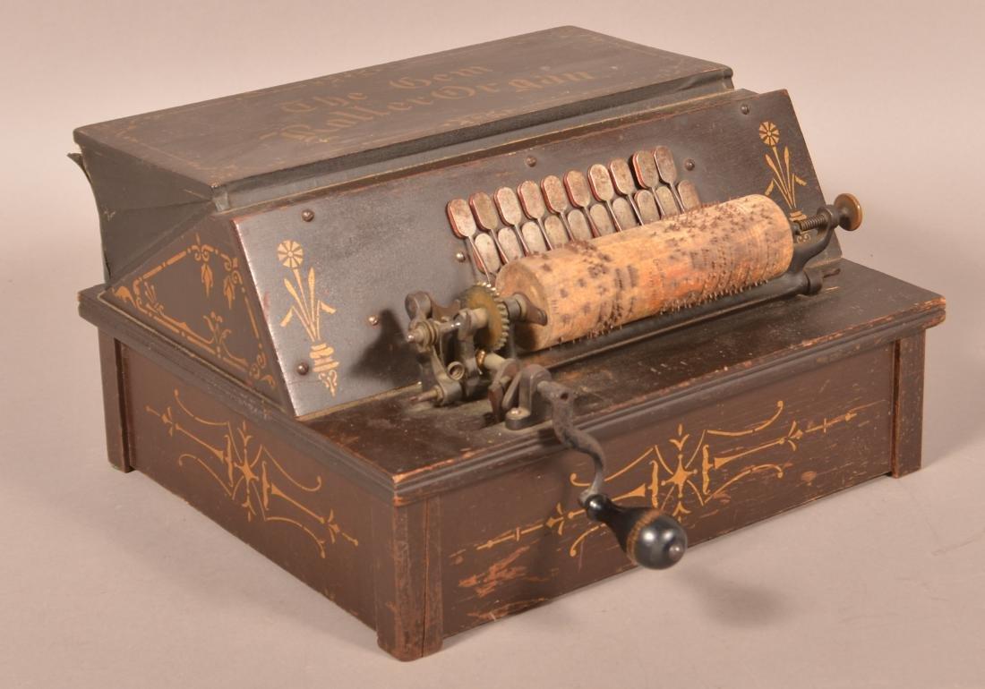 """The Gem Roller Organ"" with 14 Rolls."