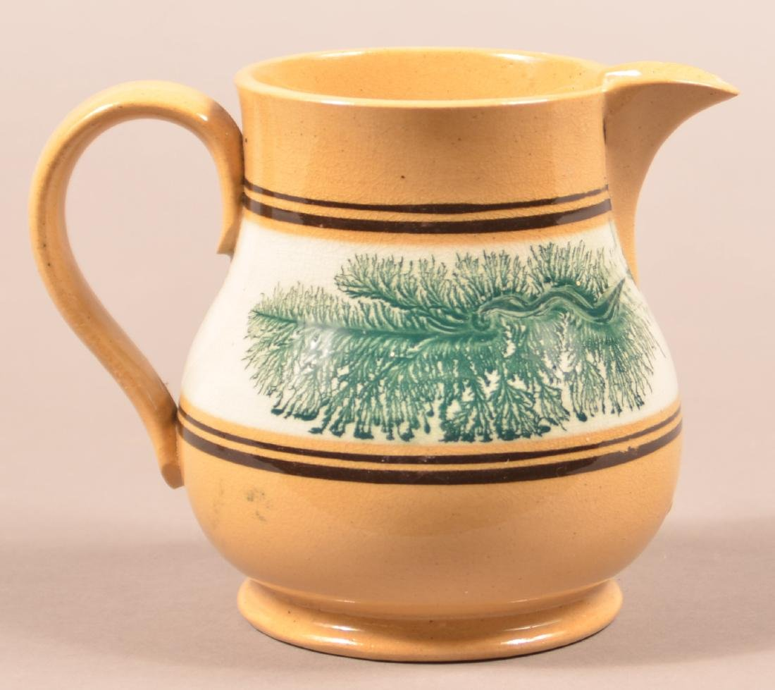Yellowware Pitcher with Seaweed Decoration.