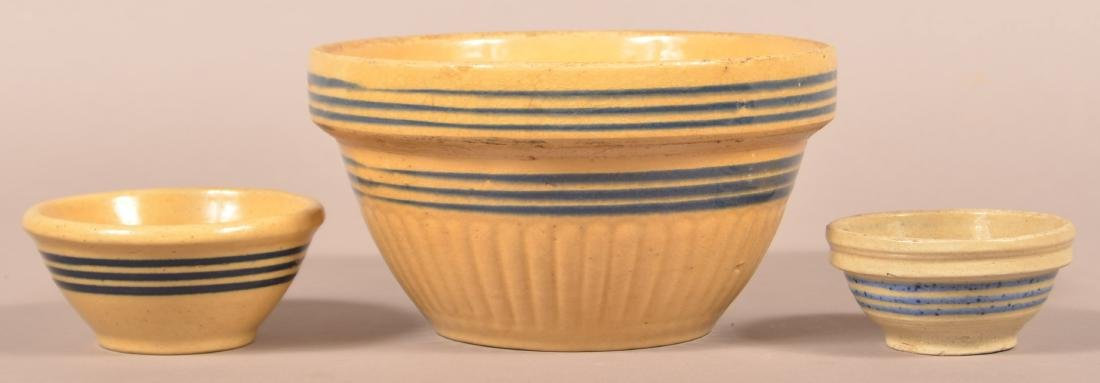 Three Pottery Bowls with Blue band Decoration.