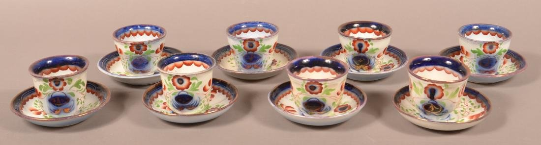 "8 Gaudy Ironstone ""Seeing Eye"" Cups and Saucers."