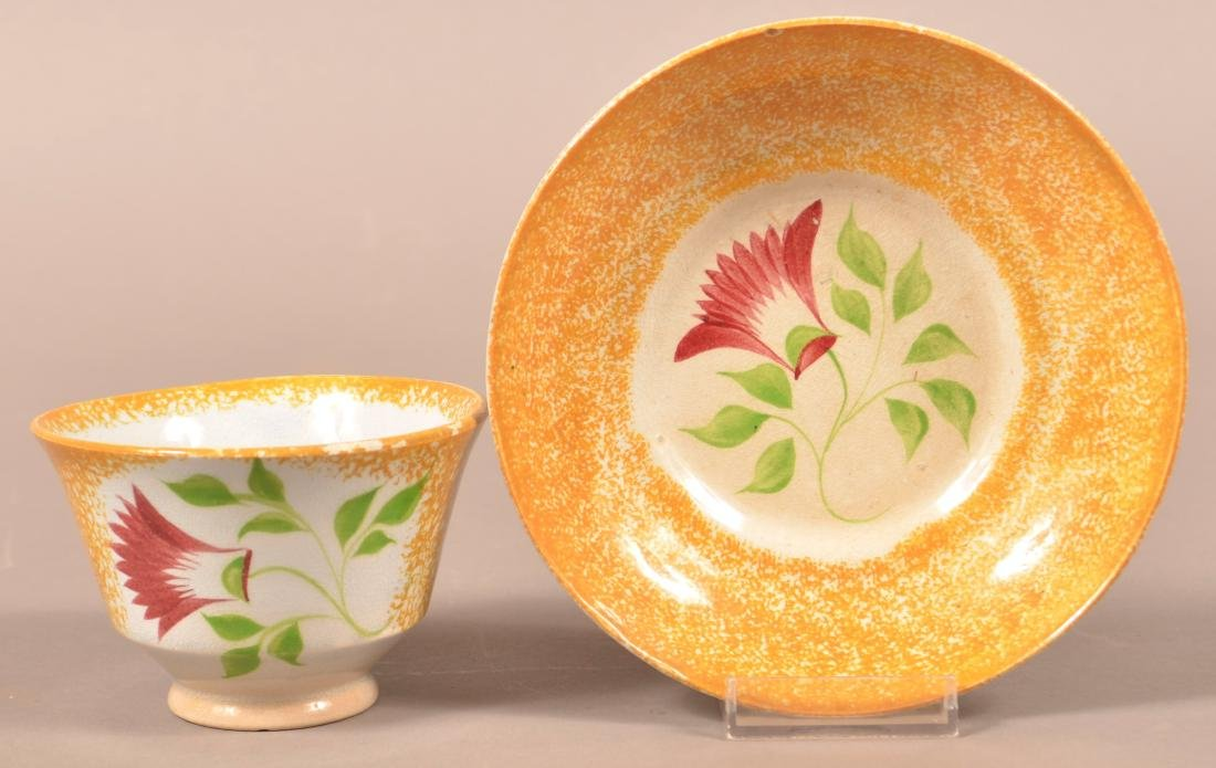 Yellow Spatter Thistle Pattern Cup and Saucer.
