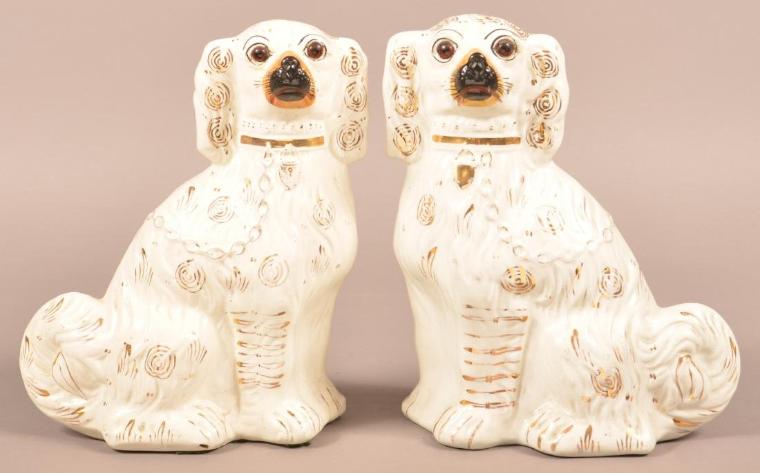 Pair of Staffordshire China Seated Spaniel Figures.