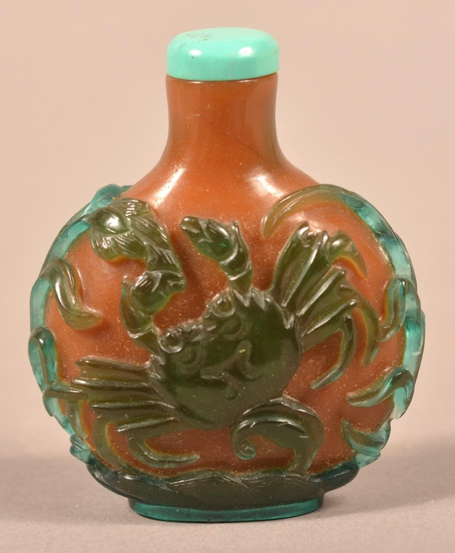 Green & Amber Colored Peking Glass Snuff Bottle.
