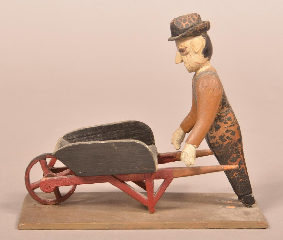 Folk Art Carving of a Man with Wheel Barrow. - 2