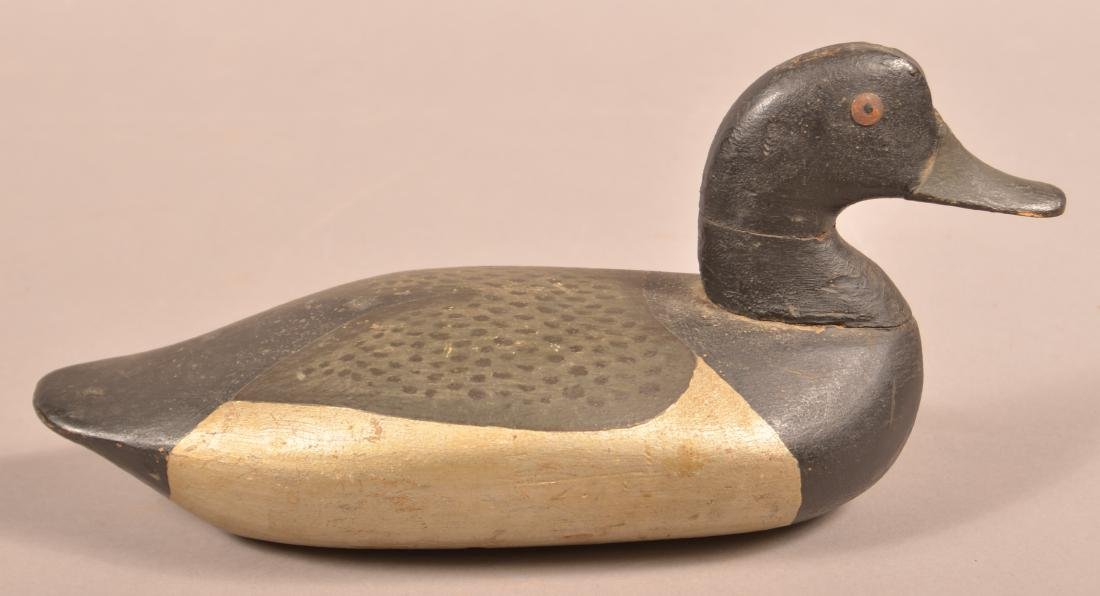Carved and Painted Blue Bill Drake Decoy.