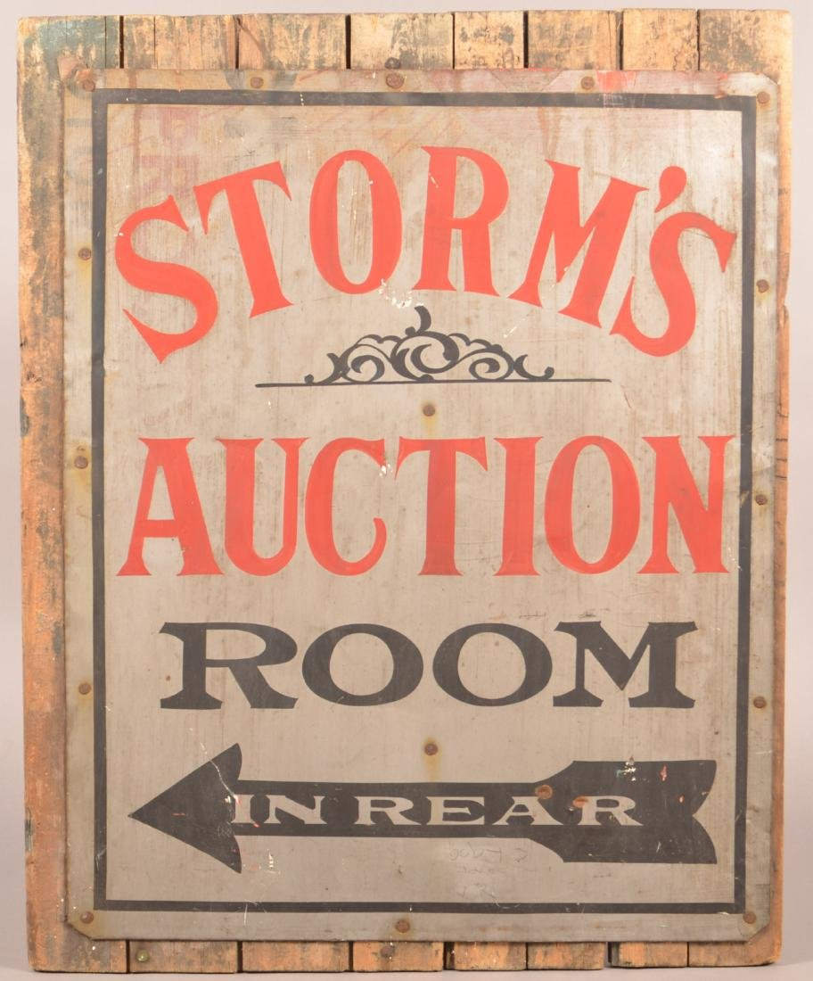 "Vintage ""Storm's Auction Room"" Tin Sign."