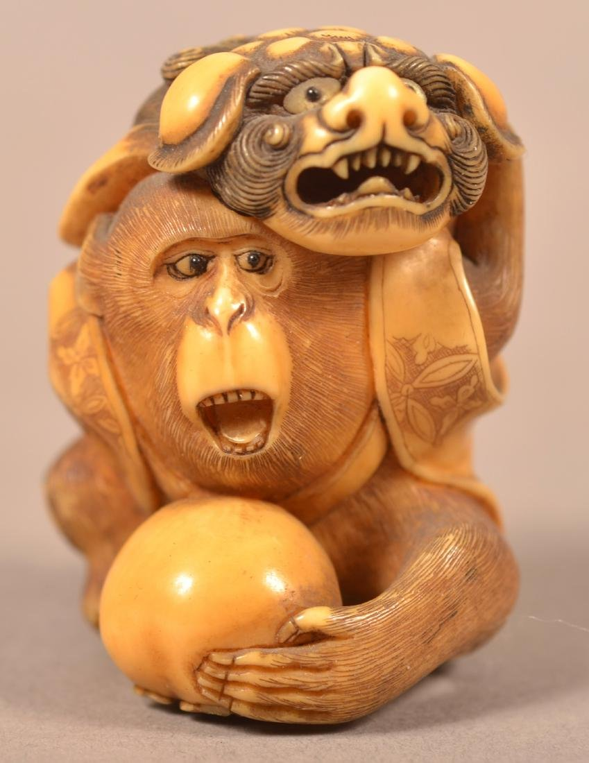 Carved Monkey with Foo Dog Cape Netsuke.