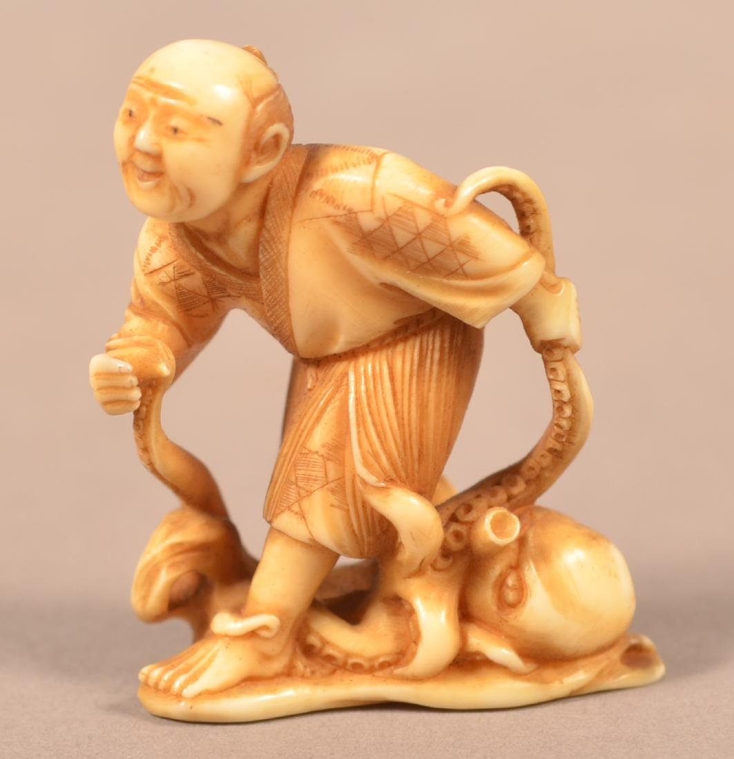 Antique Carved Fisherman with Octopus Netsuke.