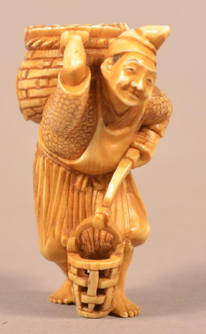 Antique Carved Man with Baskets Netsuke.