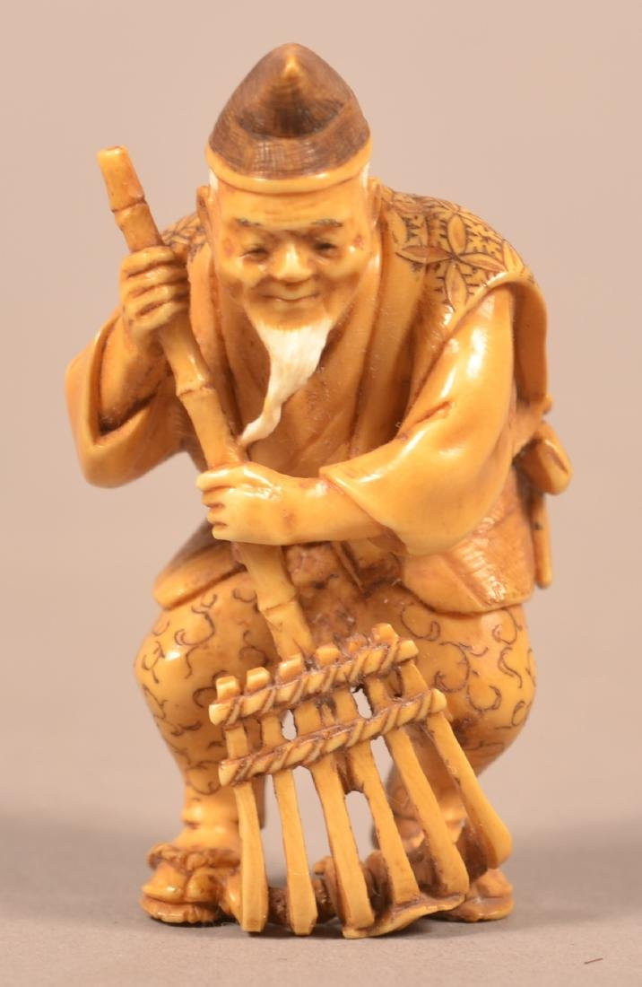 Antique Carved Man with Rake Netsuke.