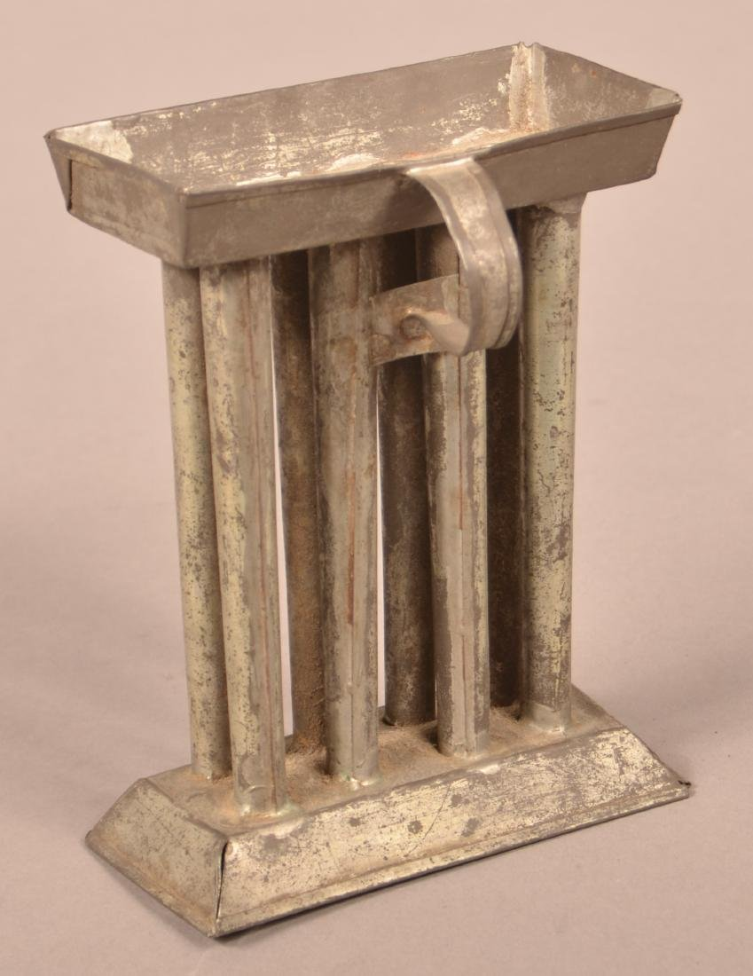 Small 19th Century Tin Eight Tube Candle Mold.