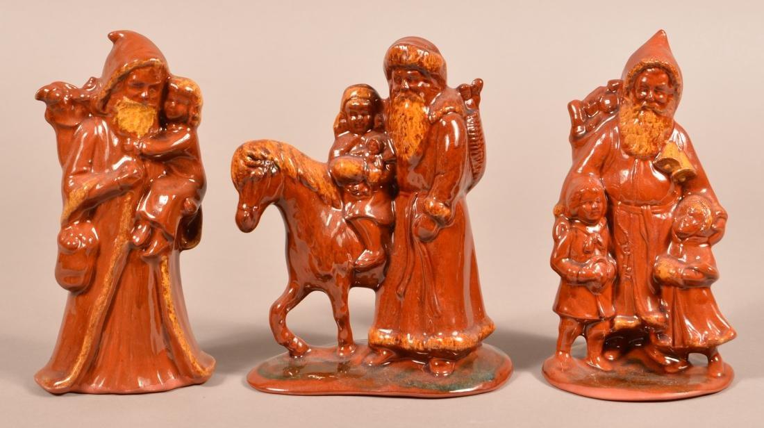 Three Foltz Redware Molded Santa Figures.