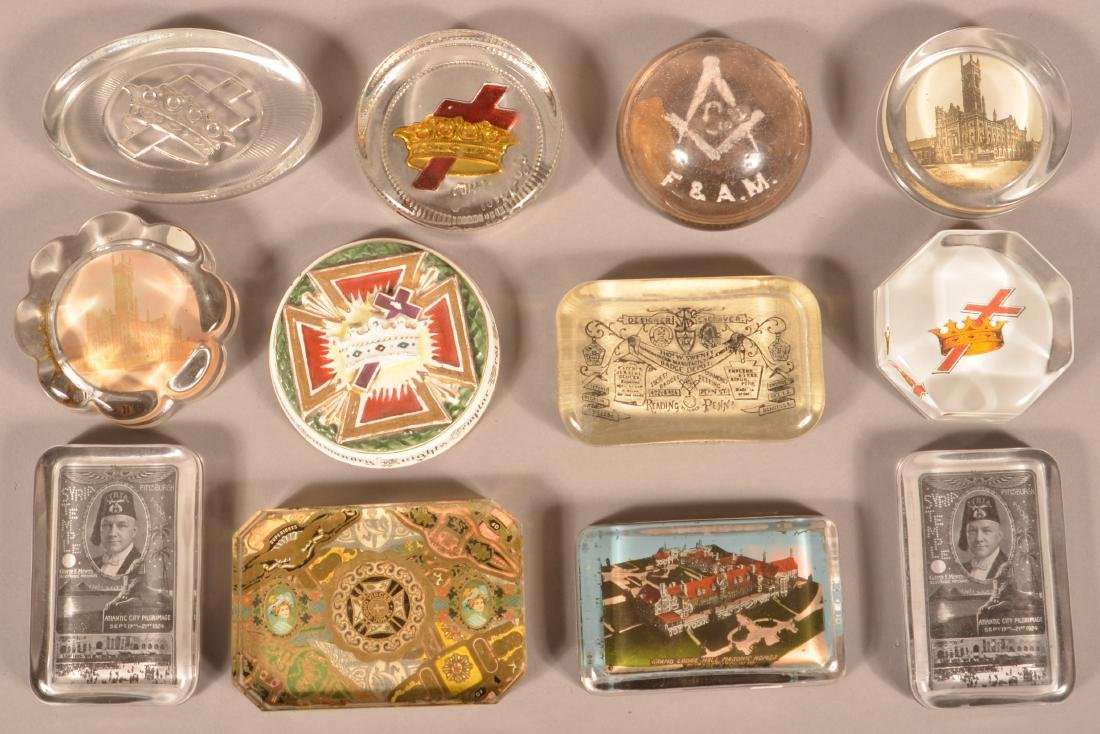 Twelve Various Masonic Paperweights.